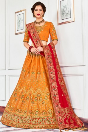 Excellent Silk Orange Stone Work And Hand Work Lehenga Choli And Dupatta