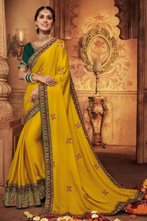 Appealing Yellow Embroidred And Stone Work Silk Saree With Border Work Blouse