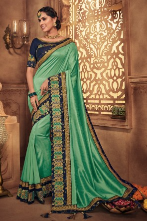 Classy Turquoise Embroidred And Stone Work Silk Saree With Border Work Blouse
