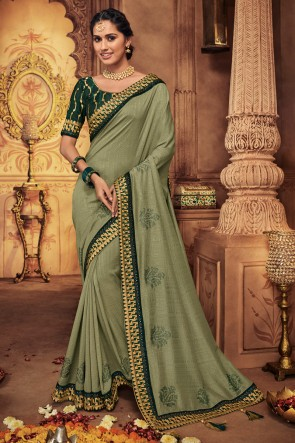 Appealing Mehendi Green Embroidred And Stone Work Silk Saree With Border Work Blouse
