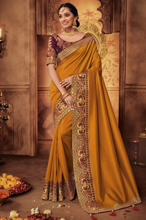 Pretty Embroidred And Stone Work Mustard Silk Saree With Border Work Blouse