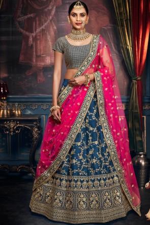 Turquoise Silk Fabric Stone And Embroidery Work Lehenga Choli With Net Dupatta