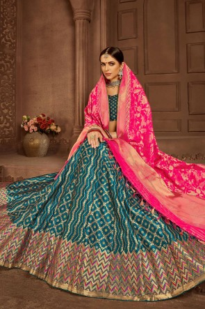 Supreme Teal Jacquard Work And Weaving Work Banarasi Silk Lehenga Choli And Dupatta