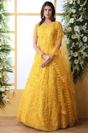 Party Wear Net Fabric Yellow Stone And Thread Work Abaya Style Anarkali Suit With Net Dupatta
