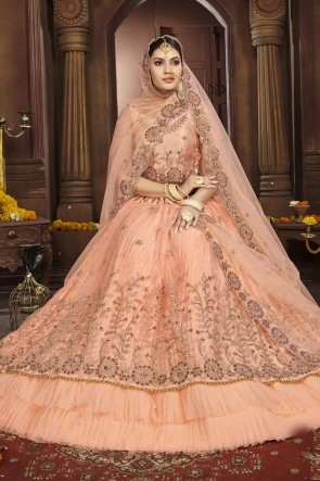 Peach Embroidered And Stone Work Net Fabric Designer Lehenga Choli And Dupatta