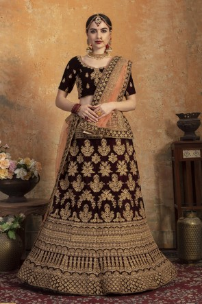Maroon Embroidered And Zari Work Velvet Fabric Lehenga Choli With Net Dupatta
